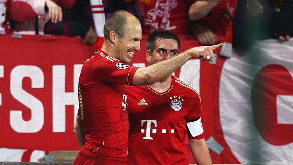 Arjen Robben celebrates after doubling Bayern's advantage at Marseille