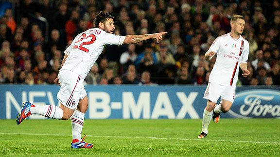 Antonio Nocerino celebrates after he brought Milan back on level terms at Camp Nou.