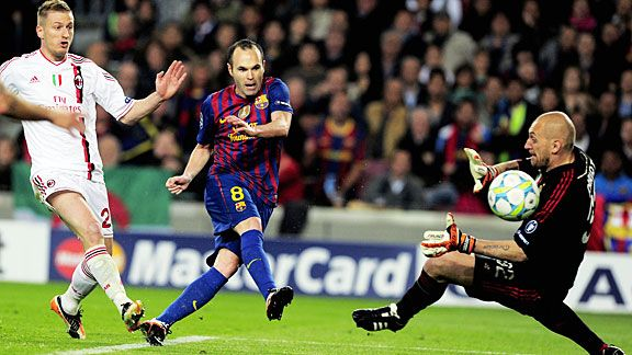 Andres Iniesta lifts the ball past Christian Abbiati to make it 3-1 to Barca.