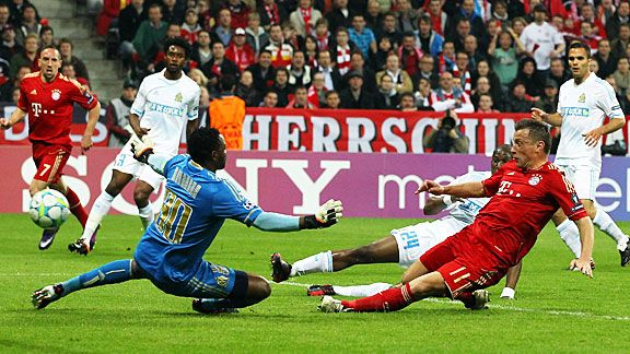 Ivica Olic slides in to give Bayern Munich the lead against Marseille