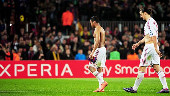 Robinho and Zlatan Ibrahimovic trudge off after their defeat at Camp Nou.