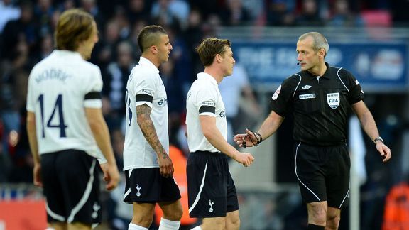 Tottenham protest to referee Martin Atkinson following the award of a goal for Juan Mata