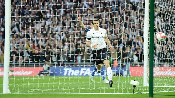 Gareth Bale fires the ball into the empty net to give Spurs hope