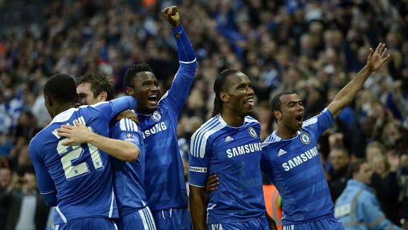 Frank Lampard celebrates with his team-mates after netting Chelsea's fourth