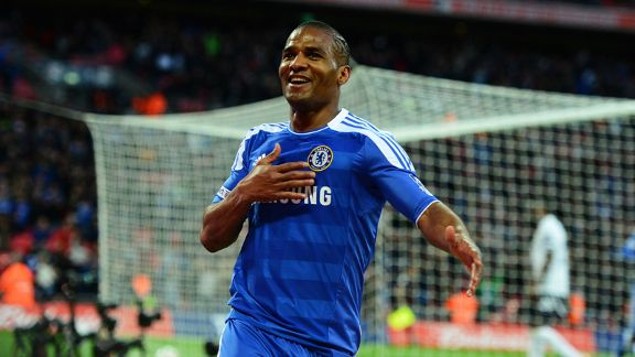Florent Malouda celebrates as he adds Chelsea's fifth as the Blues beat Tottenham 5-1 at Wembley.