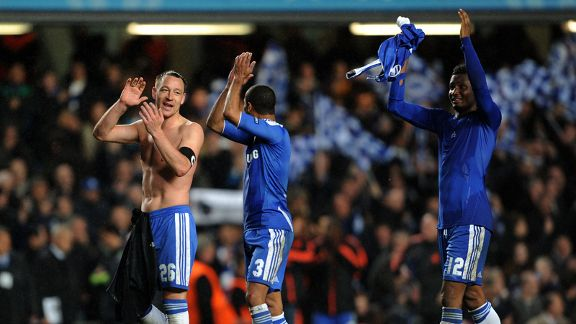 Chelsea players celebrate in front of the club's fans at Stamford Bridge
