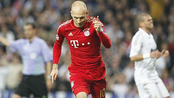 Arjen Robben celebrate after scoring a vital penalty for Bayern at the Bernabeu, making it 3-3 on aggregate.