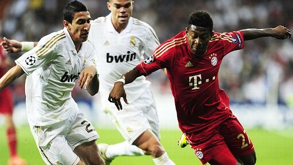 Angel di Maria and David Alaba battle for the ball.
