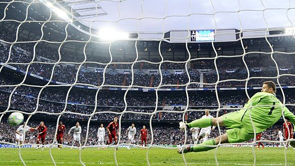 Cristano Ronalo sends Manuel Neuer the wrong way to give Real Madrid the lead from the spot.