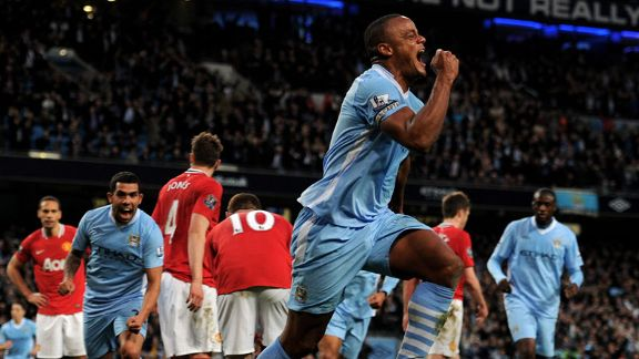 Vincent Kompany celebrates after heading City into the lead