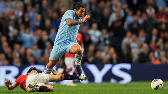 Park Ji-Sung attempts to dispossess former team-mate Carlos Tevez