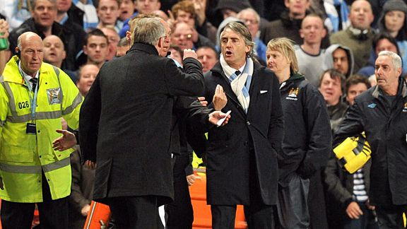 Sir Alex Ferguson confronts Roberto Mancini over a Nigel de Jong tackle