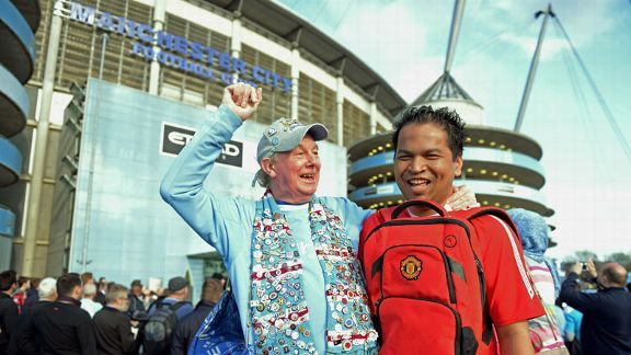 Manchester City and Manchester United fans enjoy the build-up to the derby