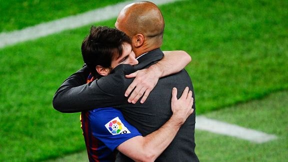 Lionel Messi hugs Pep Guardiola