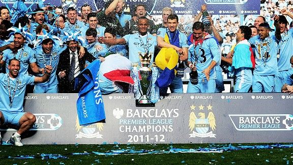 Man City players celebrate their dramatic title win