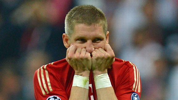 Schweinsteiger reacts to missing his penalty in the shootout
