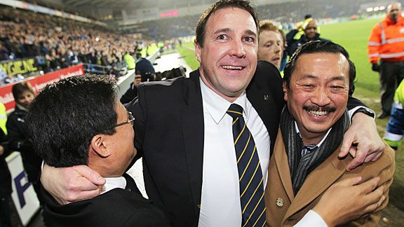 Cardiff boss Malky Mackay (c) celebrates with owner Tan Sri Vincent Tan Chee Yioun (r) and chairman Chan Tien Ghee (l).