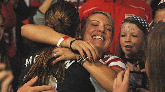 Alex Morgan celebrates with friends in the crowd