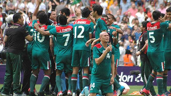 Going for gold: Mexico's players celebrate their famous victory