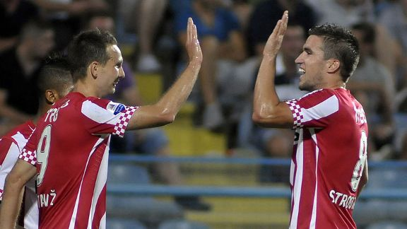 Tim Matavz and Kevin Strootman celebrate during PSV's 5-0 over Zeta