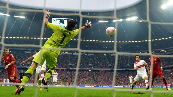 Bastian Schweinsteiger heads in Bayern Munich's six goal