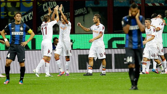 Roma celebrate Marquinho's goal against Inter Milan