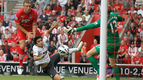 Southampton's Rickie Lambert, left, jumps above Manchester United's Rafael to score