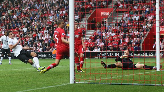 Robin van Persie scores his and Manchester United's second goal