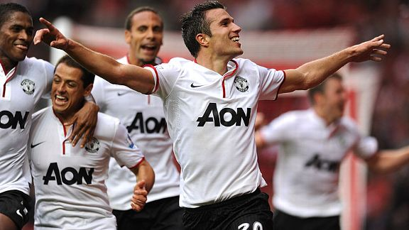 Robin van Persie celebrates scoring his side's third goal