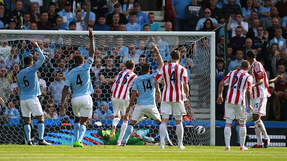 Peter Crouch puts Stoke into the lead as the Man City defence appeal in vain for a handball