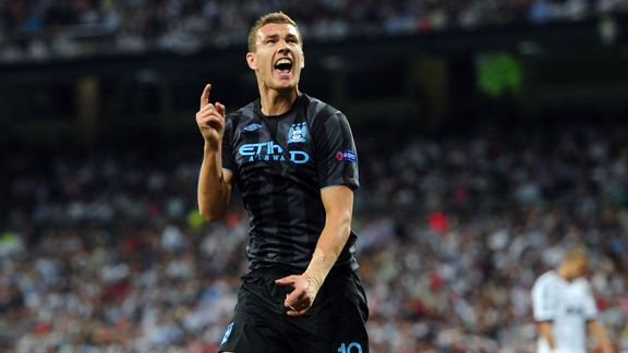Edin Dzeko celebrates after firing Manchester City into the lead at the Bernabeu