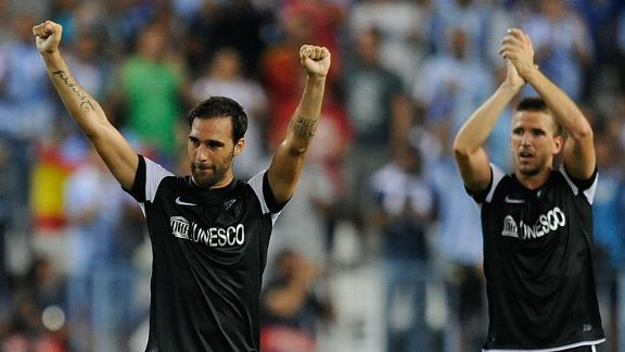 Jesus Gamez and Ignacio Camacho celebrate Malaga's victory