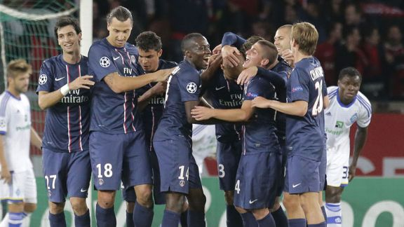 PSG celebrate after going 3-0 up against Dynamo Kiev through Alex
