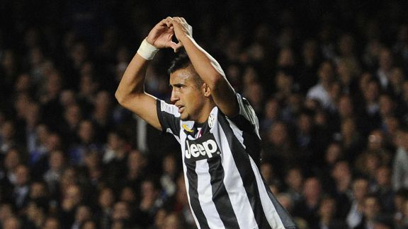 Arturo Vidal celebrates after pulling a goal back for Juventus at Chelsea