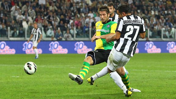 Fabio Quagliarella scores his and Juventus' second goal of the game against Chievo