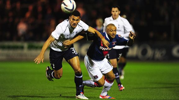 Carlisle striker Danny Cadamarteri tussles for the ball with Steven Caulker of Spurs