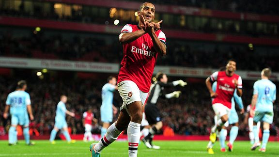 Arsenal's Theo Walcott celebrates scoring his side's sixth goal of the game