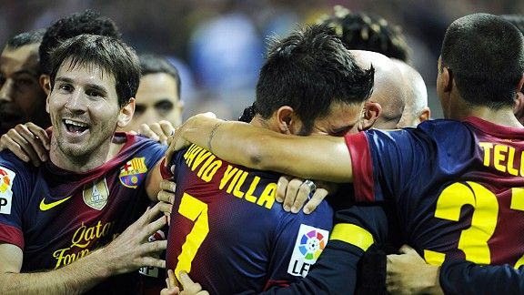 Barcelona celebrate David Villa's late, late winner at Sevilla