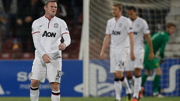 Wayne Rooney shows his frustration following Cluj's opening goal