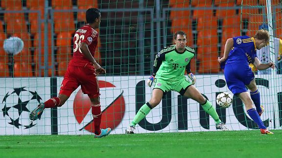 Aleksandr Pavlov of Borisov scores his team's opening goal against Bayern Munich