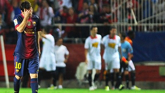 Lionel Messi hides his face as Sevilla race into a two goal lead against Barcelona