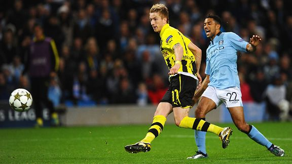 Marco Reus of Borussia Dortmund scores against Man City