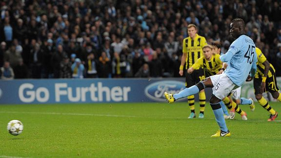 Mario Balotelli scores from the penalty spot against Borussia Dortmund