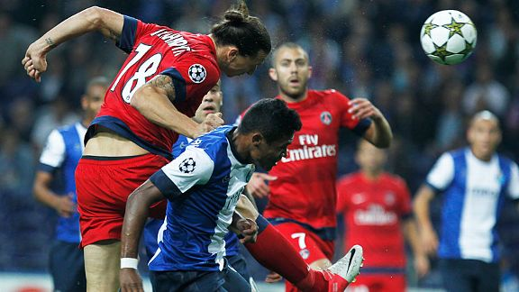Paris Saint Germain's Zlatan Ibrahimovic heads the ball past Porto's Alex Sandro