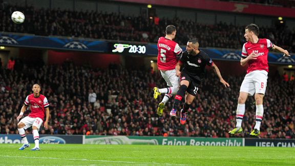 Olympiakos' Kostas Mitroglou scores the equaliser against Arsenal