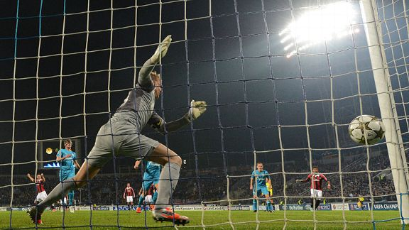Zenit goalkeeper Vyacheslav Malafeev has to pick the ball out of his net