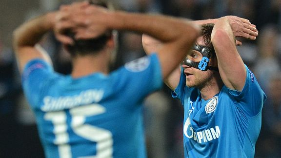 Nicolas Lombaerts of Zenit St. Petersburg reacts atfre losing to AC Milan