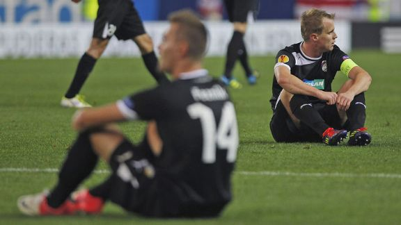 Viktoria Plzen's Radim Reznik and David Limbersky show their disappointment after their late defeat to Atletico Madrid