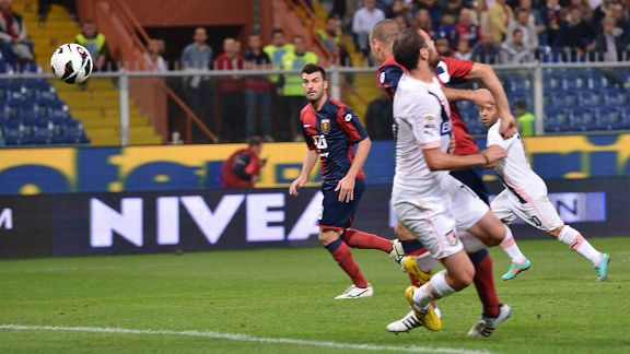 Luigi Giorgi of Palermo scores the opening goal in the 1-1 draw with Genoa