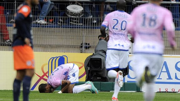 Evian's hat-trick Saber Khelifa prays after scoring against Montpellier